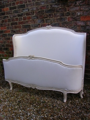 Antique French 19th Century curved head/curved foot upholstered double bed