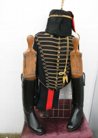 Antique British Soldiers full dress uniform with his boots.