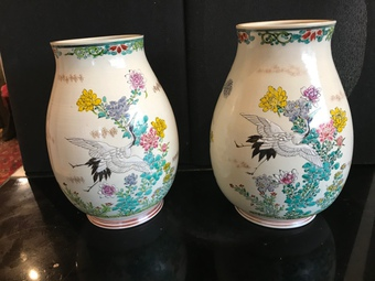 Oriental hand painted pair of Vases