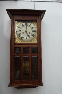 Antique Wall clock 8 day mechanical movement strikes on rods the hours