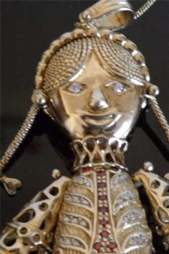 Antique Beautiful rag doll pendant in solid silver gold plated all moving parts rare