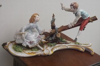 Antique porcelain girl & boy on seesaw European work