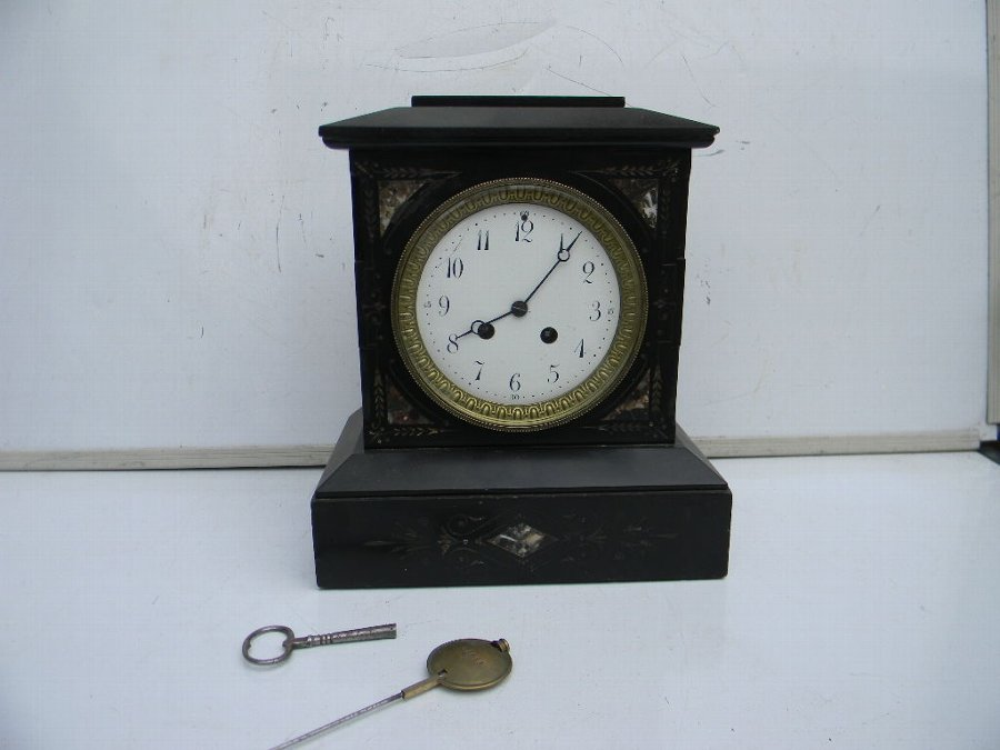 Mantle Clock Victorian 8 day mechanical movement chimes on the Half and hours.