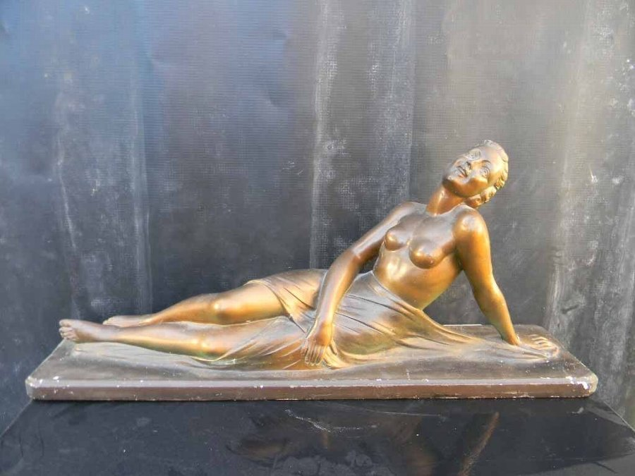Semi Nude figure of reclining woman, item of quality.