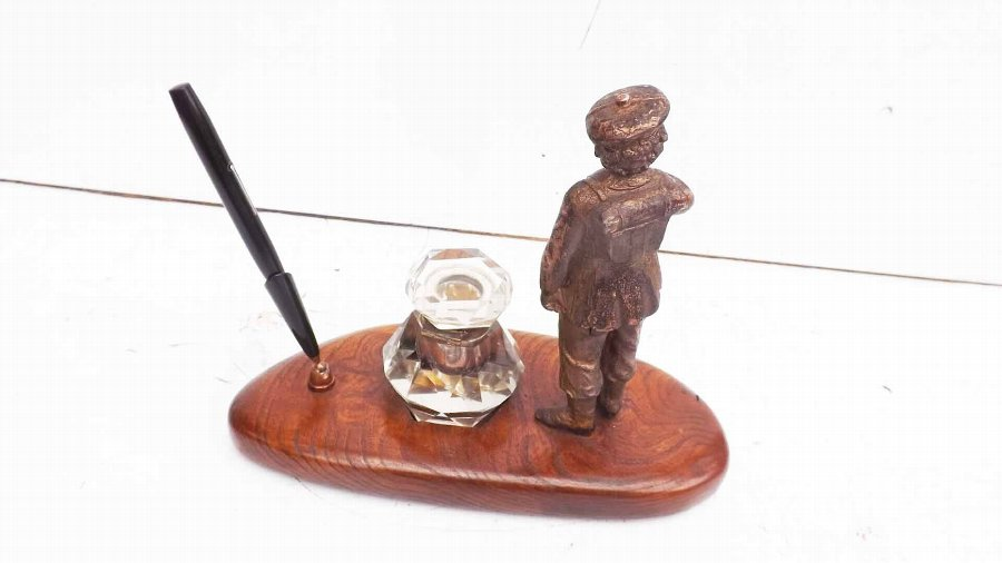 Antique antique inkwell with military theme