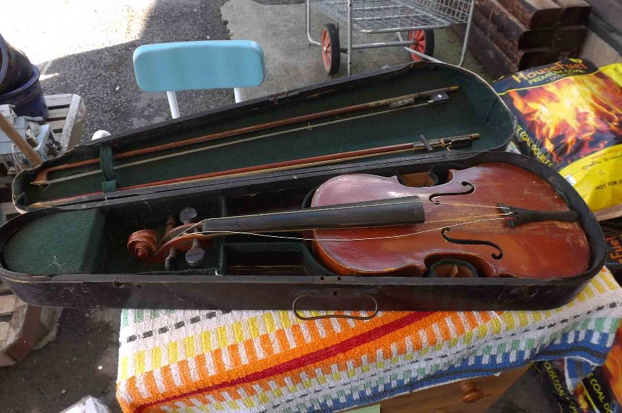 Violin with two bows and case restoration project.