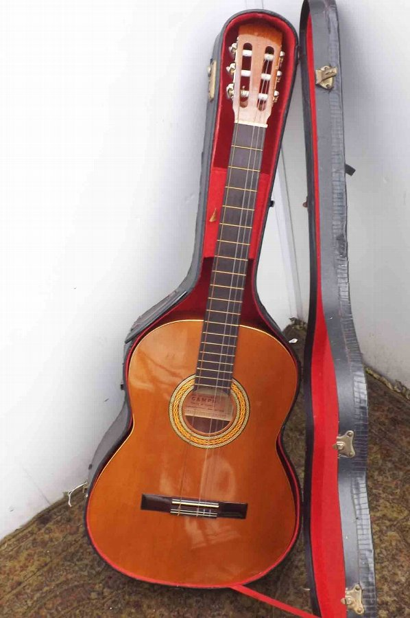 Spanish Flemenco acoustic guitar comes cased vintage item of quality.