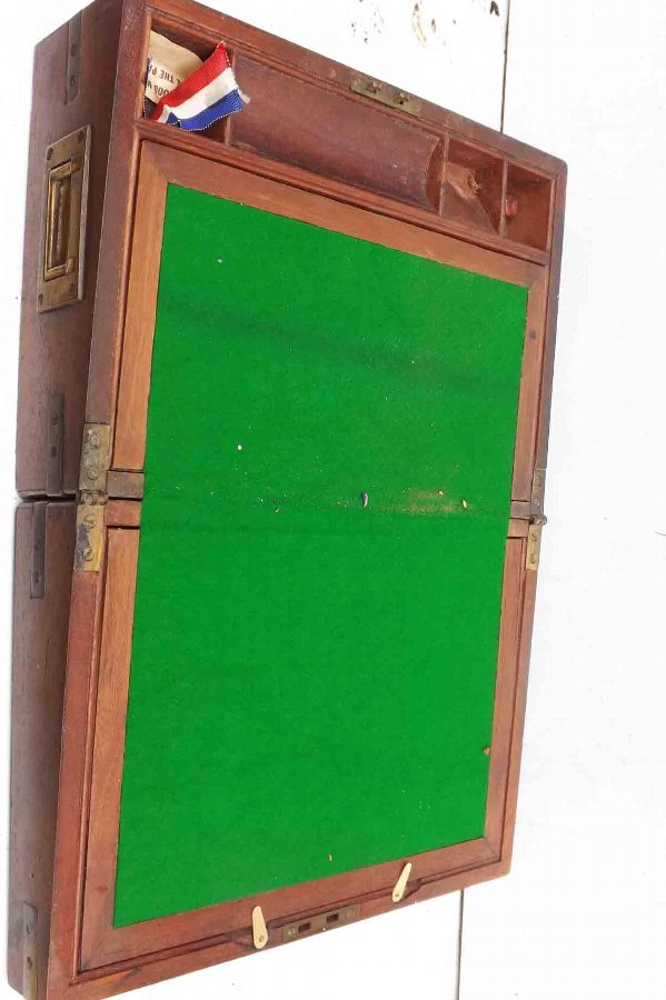 Antique writing slope in mahogany military brass bound item of quality.