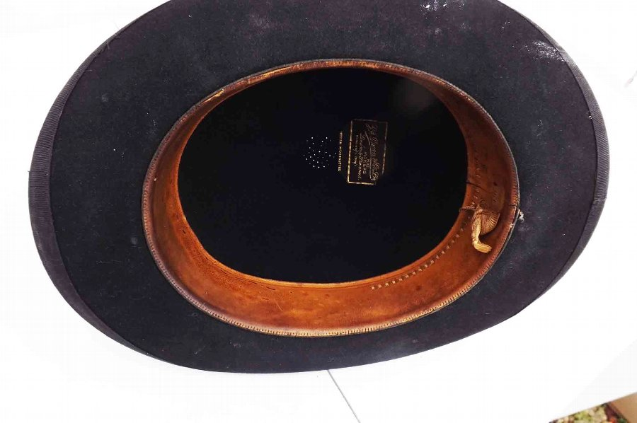 Antique black bowler hat