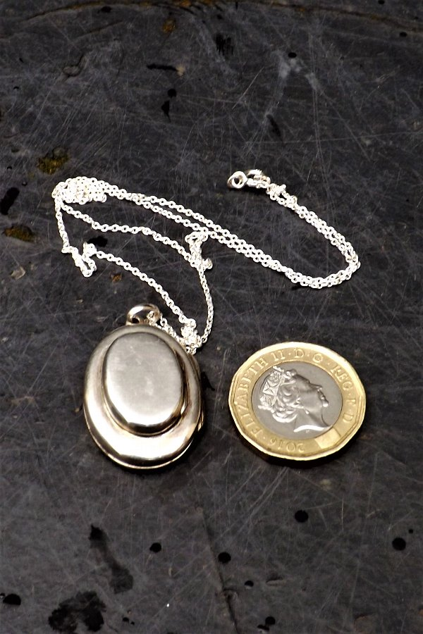 Locket rare 4 section & silver neclace