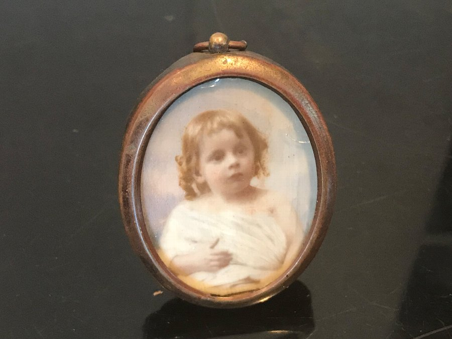 Miniature on ivory painting of young child dated 1903