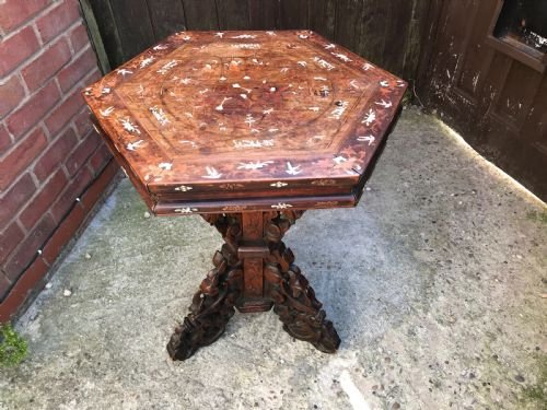 Chinese table inlaid with ivory and exotic woods.