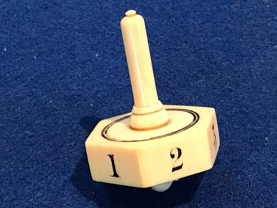 Ivory spinning dice