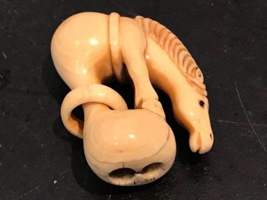 Japanese ivory carved netsuke of a horse