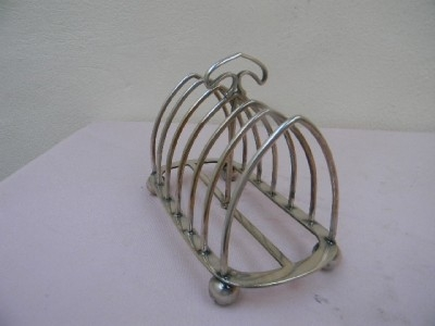 Silver toast rack by Mappin Brothers item of quality.B2