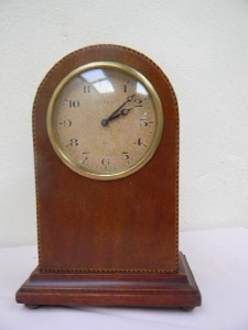 Clock mantel mahogany with inlay 8 day mechanical movement time piece.B2