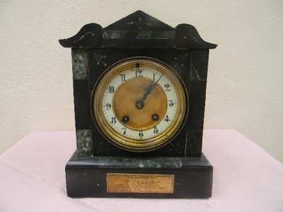 Victorian slate clock movement is mechanical 8 day strikes the hours. Quality