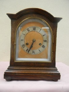 Bracket clock Edwardian oak cased movement mechanical 8 day strikes the hours