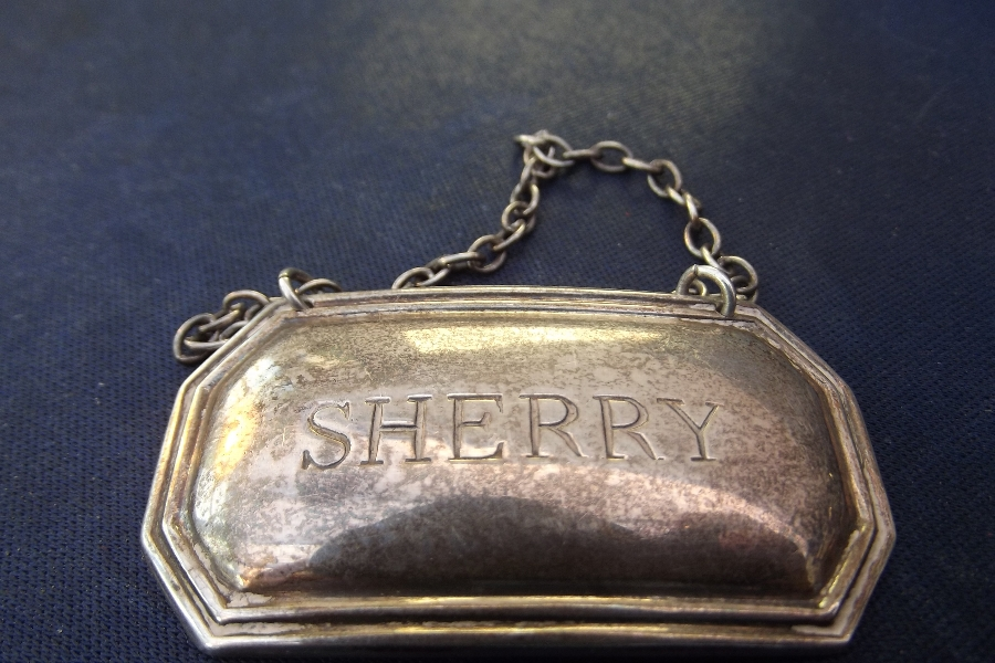 Silver decanters sherry label