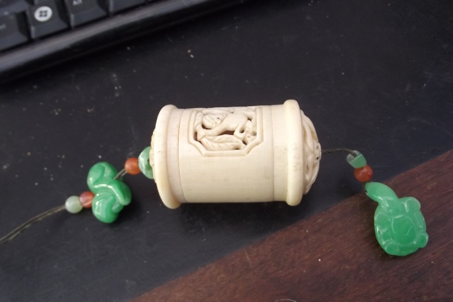 Ivory and jade Japanese cricket cage