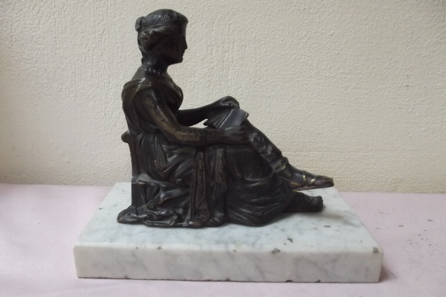 Bronze of Clasical woman sitting on marble base.