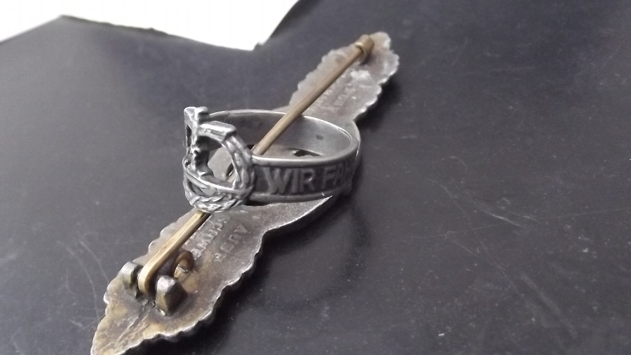 Antique German submariner 2ww badge and ring 100% genuine.B1