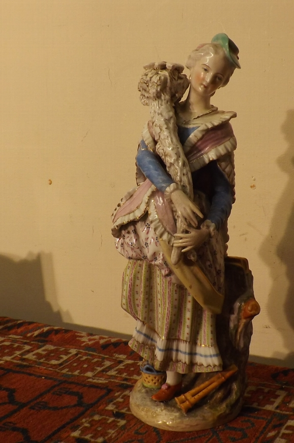 Continental Porcelean figure of Woman with flowers. quality at its best.  SB