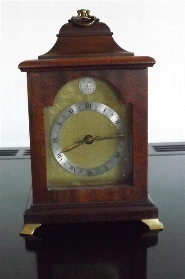 Bracket clock mahogany case 8 day mechanical movement strikes the hours.--TS