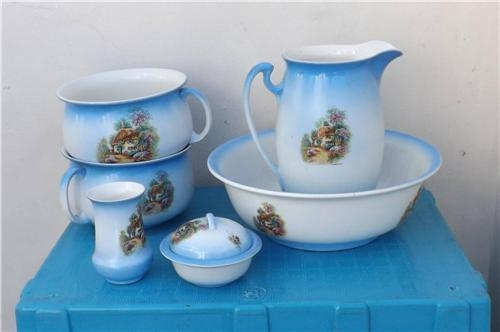 Jug & basin with his and her pottys and soap and shaving brush pots. Victorian