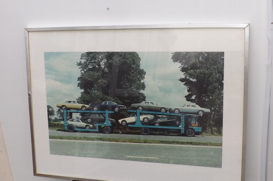 Jaguars XJ6 & E type first to be delivered on the Transporter, rare print.