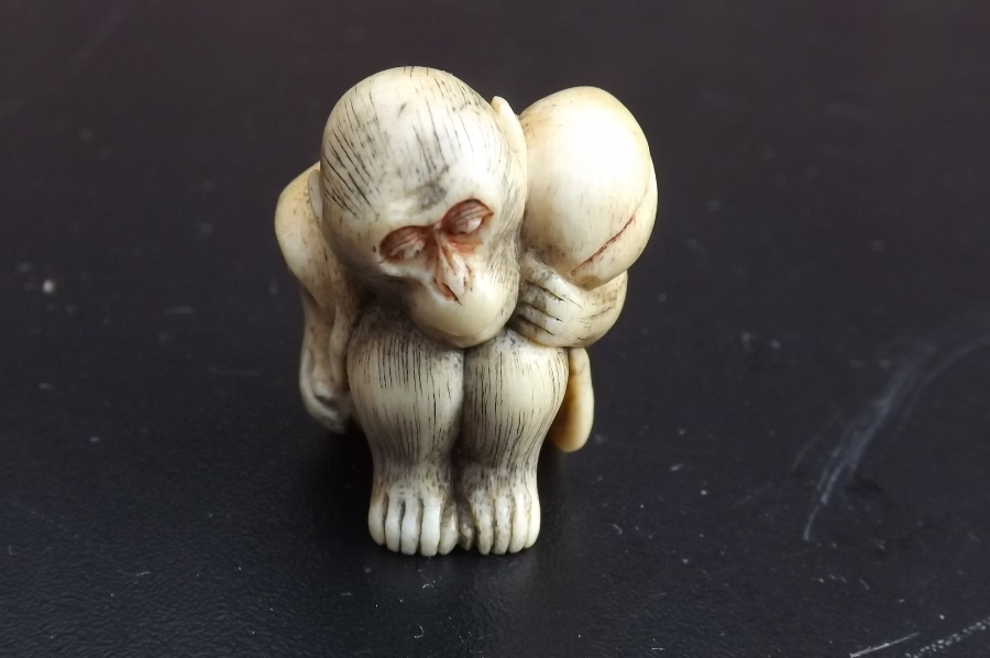 Netsuke of Monkey with his nut. CC
