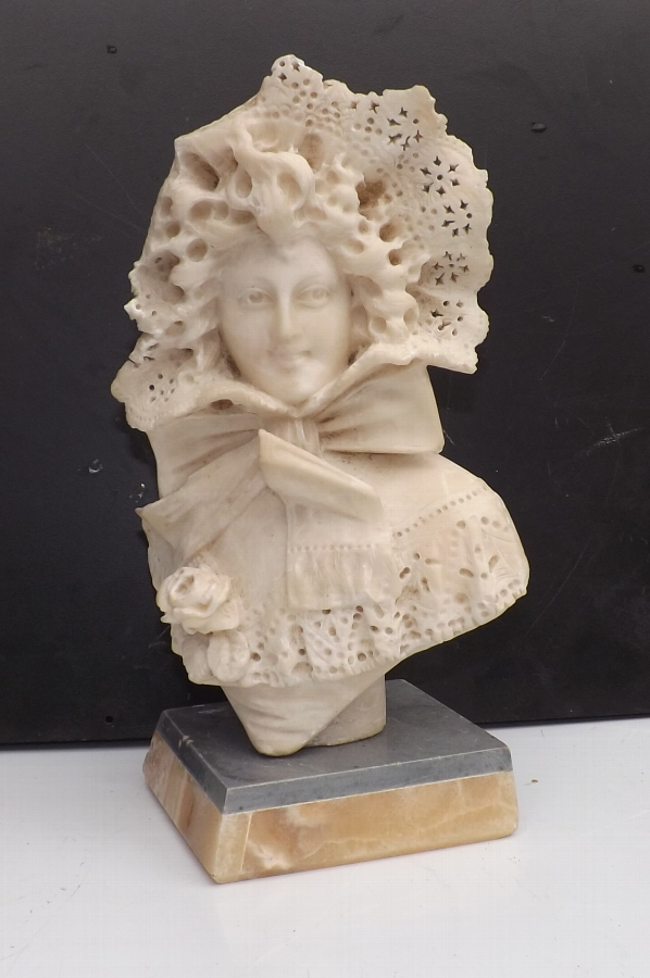 Carved marble figure of Georgian lady in her bonnet & blouse