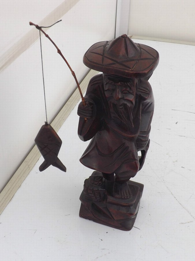 Carved Chinese figure of fisherman Victorian