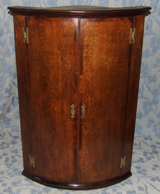 Antique Antique GEORGIAN Oak & Mahogany Bow Fronted Corner Cupboard with Spice Drawers