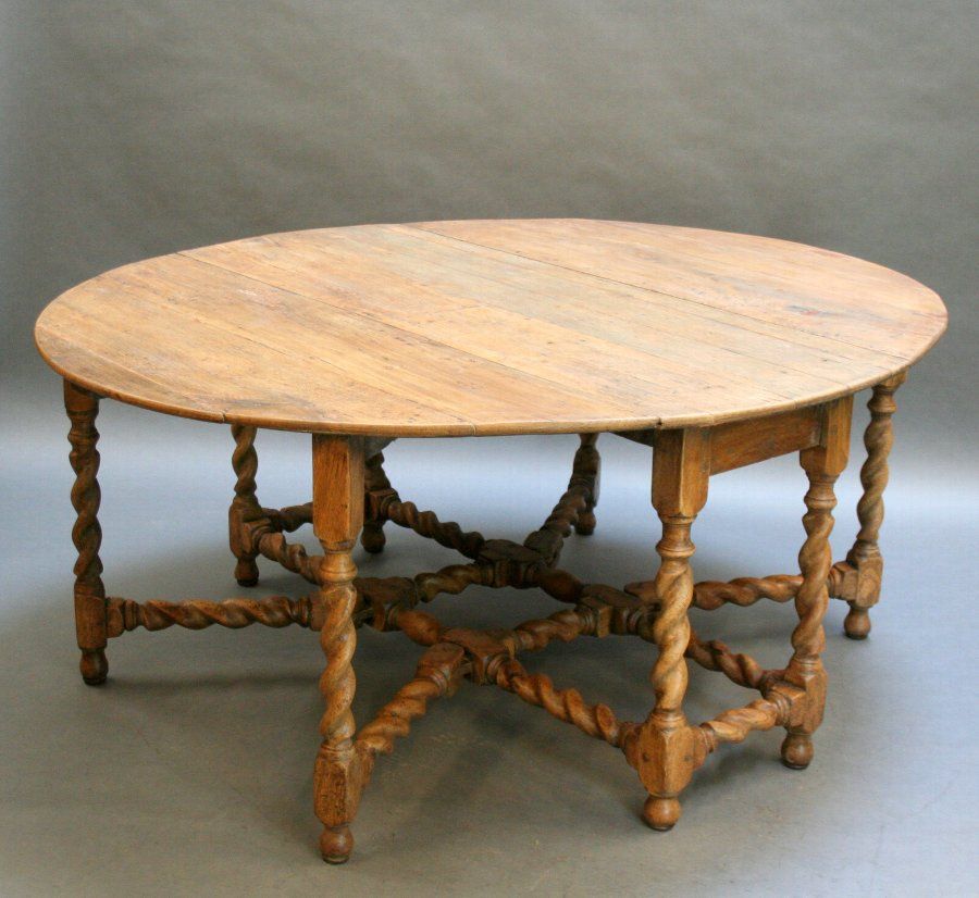 Georgian oak drop leaf dining table