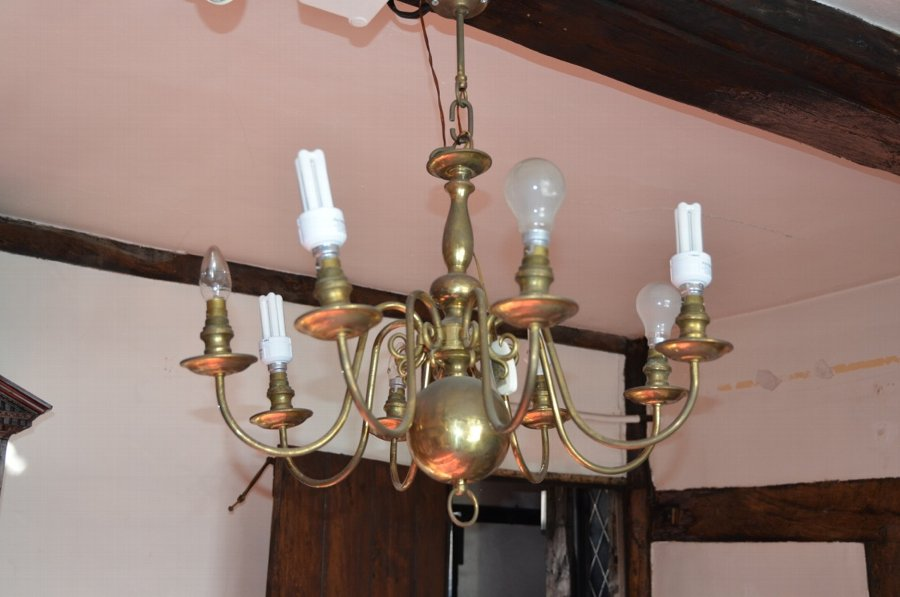 An original and unrestored dutch 8 arm chandelier