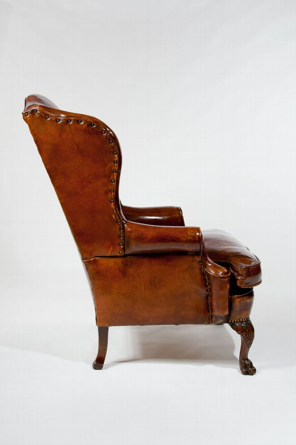 Antique Antique Leather Upholstered Wing Chair