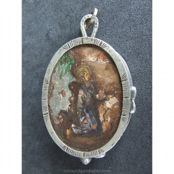 Antique Medallion locket type. Santo reading