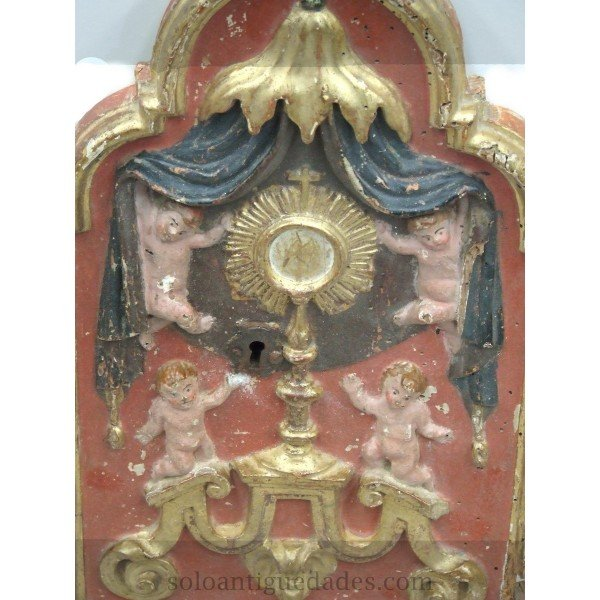 Antique Tabernacle door decorated with reliefs