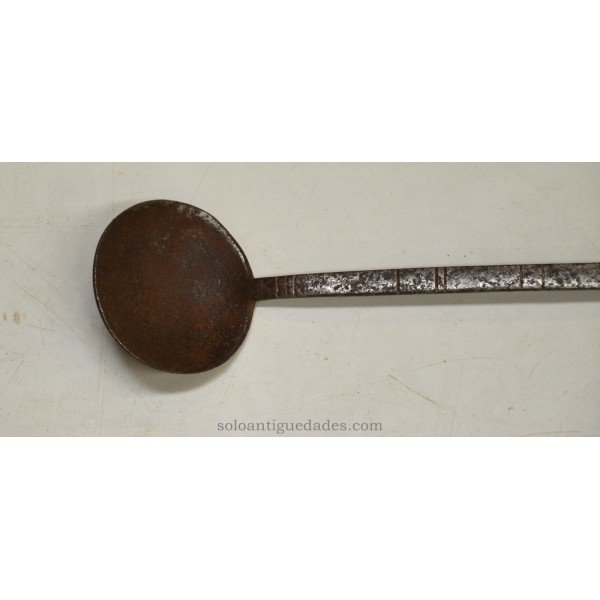 Antique Iron ladle with geometric designs on the handle