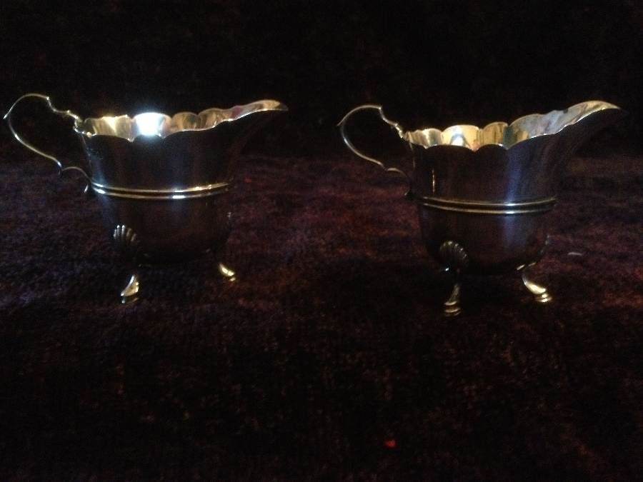 Antique fine pair of sterling silver creamers