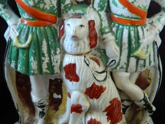 Antique Staffordshire flatback figure hunters and dog