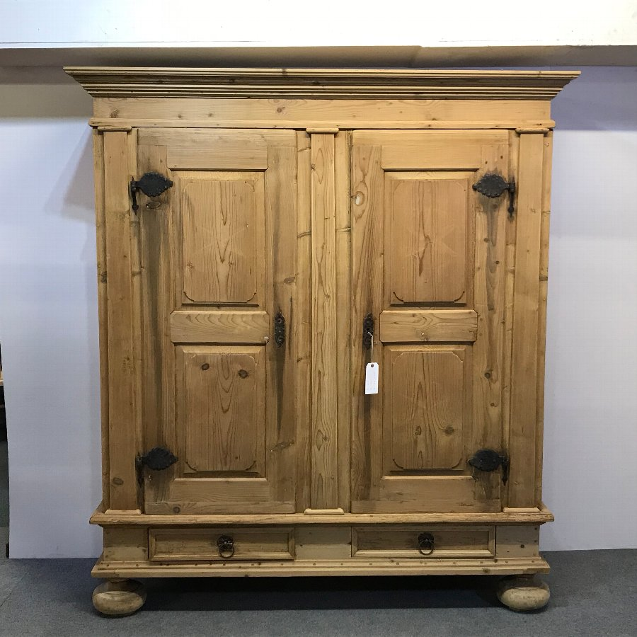 A VERY GRAND OLD PINE GERMAN WARDROBE (DISMANTLES)