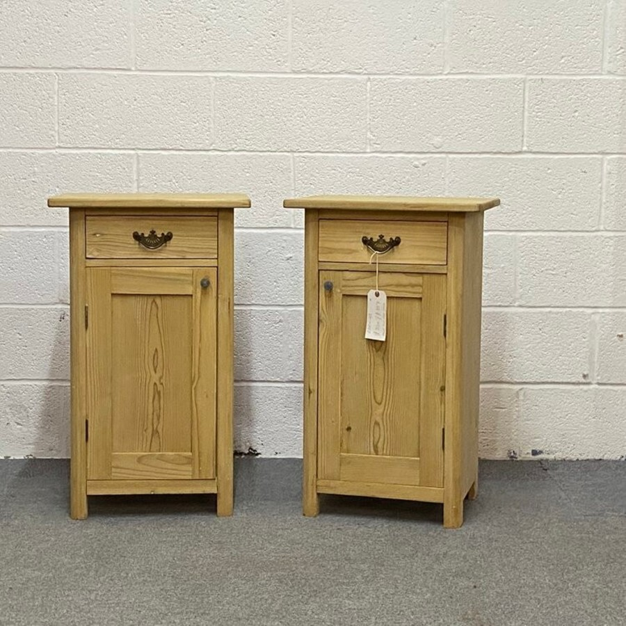 A PAIR OF ANTIQUE PINE BEDSIDE CUPBOARDS