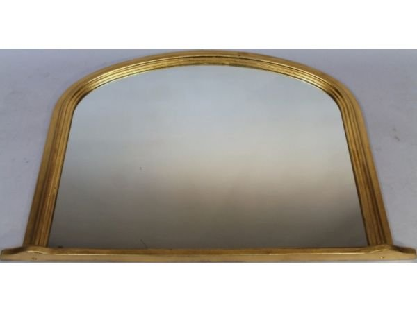 Antique A Victorian style gilt wood over mantel mirror, with a shaped D-end outline