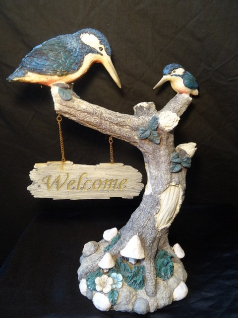 Exotic Birds Of Paradise Sitting On A Tree With Welcome Sign Sculpture
