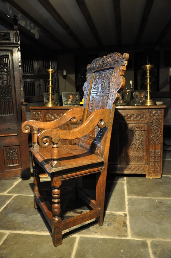 Antique A HANDSOME MID 17TH CENTURY CARVED OAK WAINSCOT ARMCHAIR. ENGLISH. CIRCA 1650