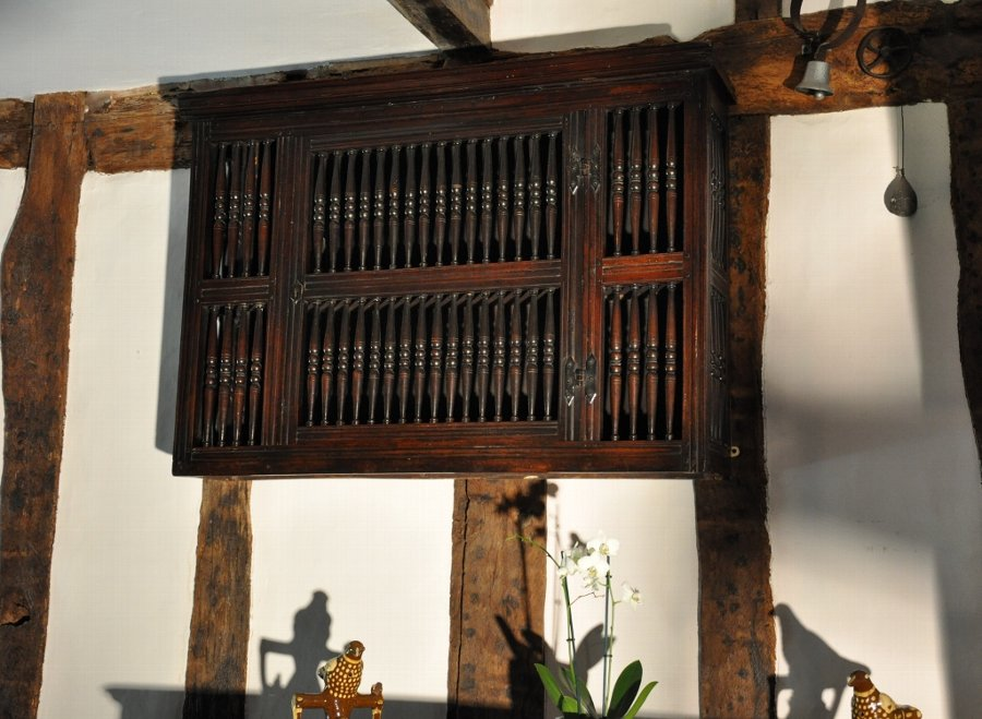 A LARGE AND RARE 17TH CENTURY ENGLISH PLUM WOOD MURAL / DOLE CUPBOARD. CIRCA 1690