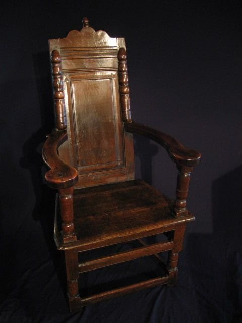 A LARGE LATE 17TH CENTURY ELM AND FRUITWOOD CAQUETEURSE ARMCHAIR. CIRCA 1690