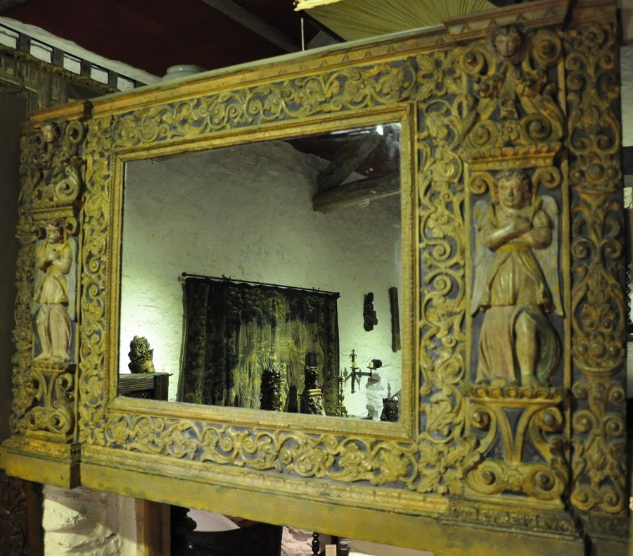 Antique AN EARLY 17TH CENTURY NORTH ITALIAN CARVED, GILDED AND POLYCHROMED MIRROR. CIRCA 1620